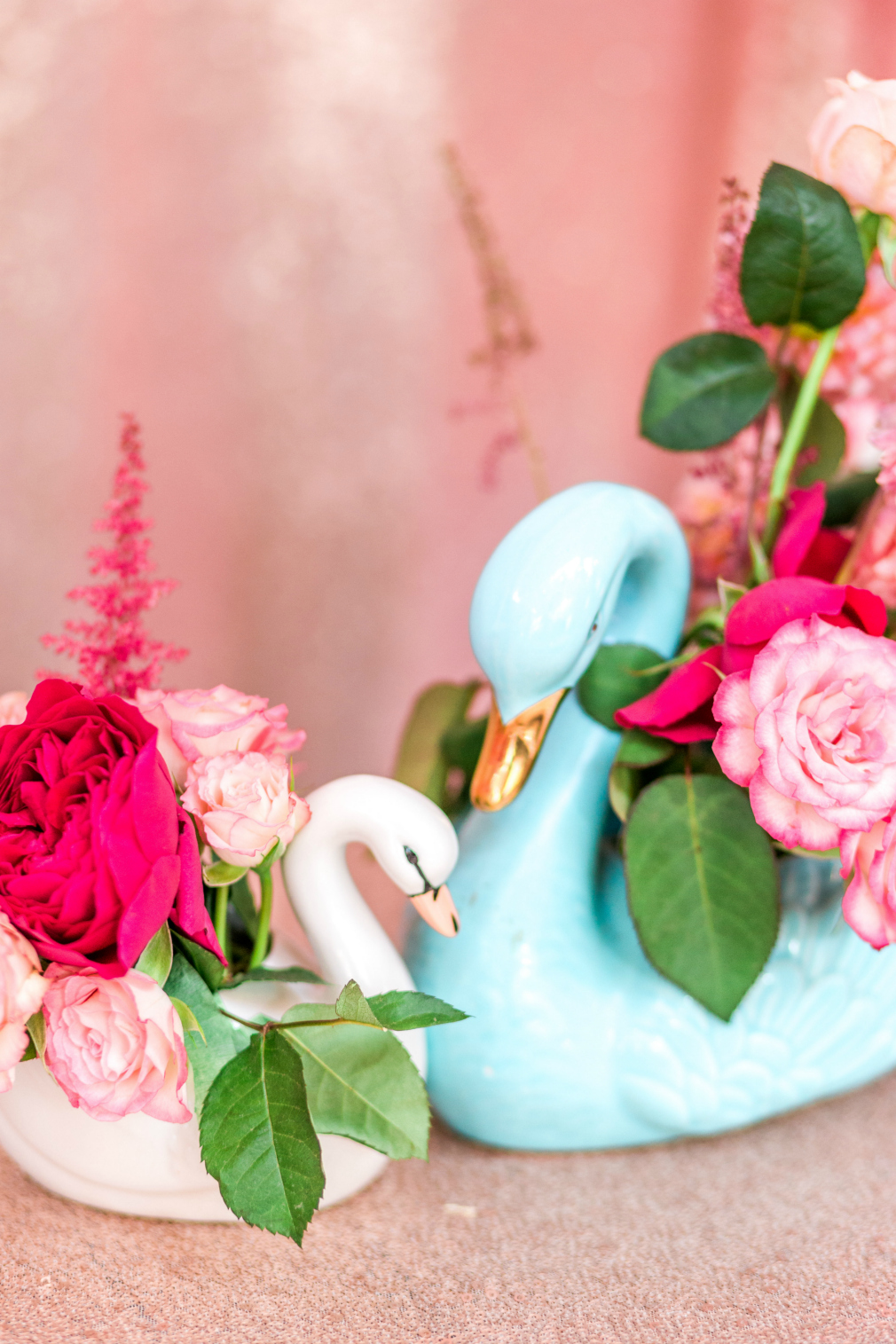 Swan floral first birthday soiree rebecca k events swans that symbolize grace and beauty filled with pretty pink flowers for a little girl whose name means flowers the decor was perfect for this little izmirmasajfo Image collections